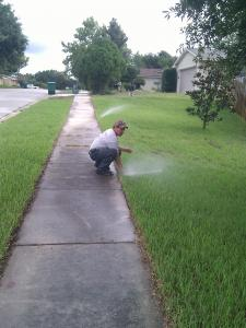 Live Oak Sprinkler Repair techs adjust every pop up head by hand